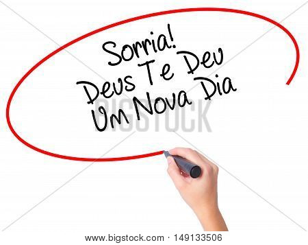 Women Hand Writing Sorria! Deus Te Deu Um Novo Dia (smile! God Gives You Another Day In Portuguese)