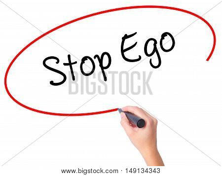 Women Hand Writing  Stop Ego With Black Marker On Visual Screen