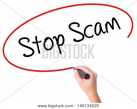 Women Hand Writing Stop Scam With Black Marker On Visual Screen