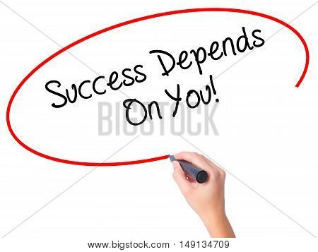 Women Hand Writing Success Depends On You! With Black Marker On Visual Screen