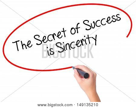 Women Hand Writing The Secret Of Success Is Sincerity With Black Marker On Visual Screen.
