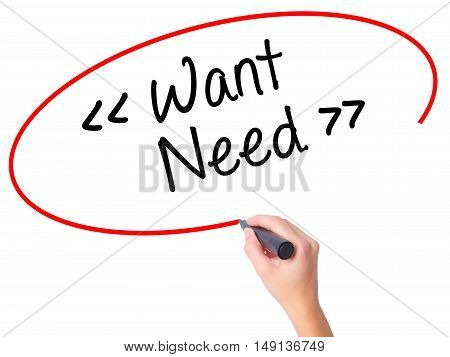 Women Hand Writing Want - Need With Black Marker On Visual Screen.