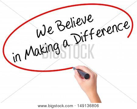 Women Hand Writing We Believe In Making A Difference With Black Marker On Visual Screen