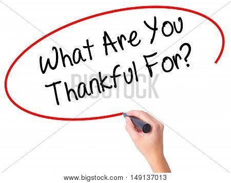 Women Hand Writing What Are You Thankful For? With Black Marker On Visual Screen