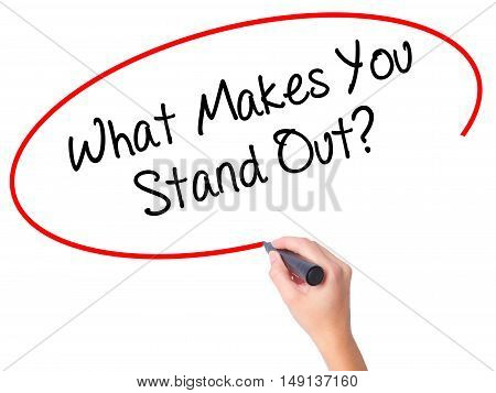 Women Hand Writing What Makes You Stand Out? With Black Marker On Visual Screen