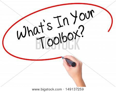 Women Hand Writing  What's In Your Toolbox? With Black Marker On Visual Screen