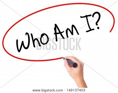 Women Hand Writing Who Am I? With Black Marker On Visual Screen