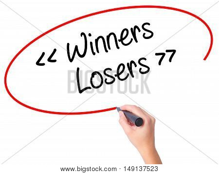 Women Hand Writing Winners - Losers  With Black Marker On Visual Screen