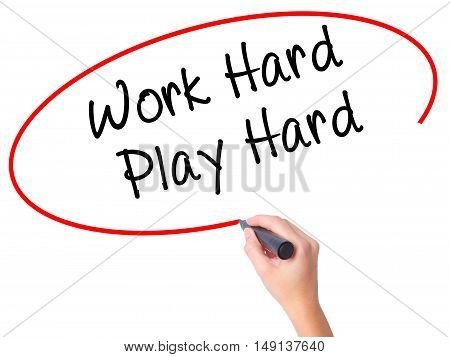 Women Hand Writing Work Hard Play Hard  With Black Marker On Visual Screen