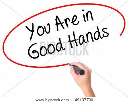 Women Hand Writing You Are In Good Hands With Black Marker On Visual Screen
