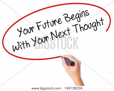 Women Hand Writing Your Future Begins With Your Next Thought With Black Marker On Visual Screen.