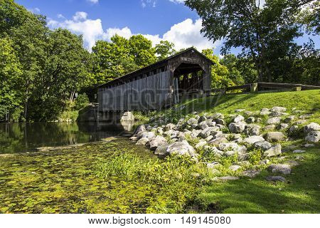 Fallasburg Covered Bridge. The historical Fallasburg covered bridge remains open to auto traffic and is located about 30 minutes from the city of Grand Rapids in Lowell Michigan.