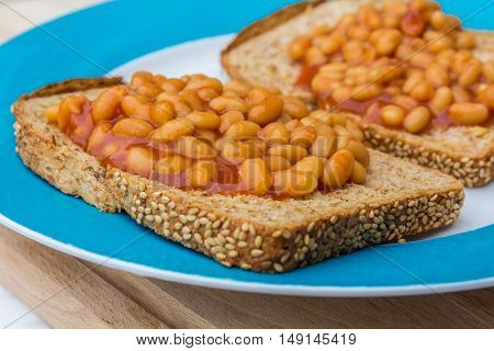 baked beans in tomato sauces on toast