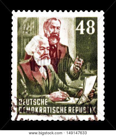 GERMAN DEMOCRATIC REPUBLIC- CIRCA 1953 : Cancelled postage stamp printed by German Democratic Republic, that shows Karl Marx and Friedrich Engels.