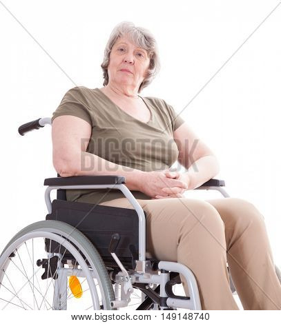 Senior woman sitting in wheelchair. All on white background.