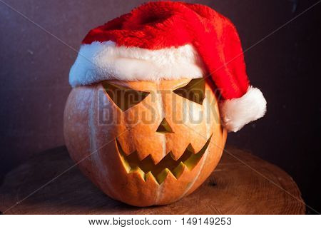 Jack-o ' - lantern in a red Santa hat, happy holidays