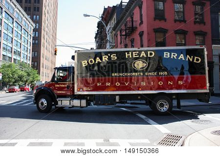 New York, NY, United States - 8 June 2010. Big truck on the road turns around corner delivering premium products to the shops. Manhattan, downtown. Truck purely washed and shining with all its surfaces.