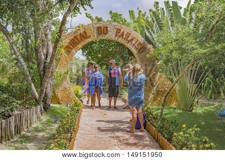 JERICOACOARA, BRAZIL, DECEMBER - 2015 - People taking photos at the entrance of Lagoa do Paraiso a famous beach of Jericoacoara Brazil