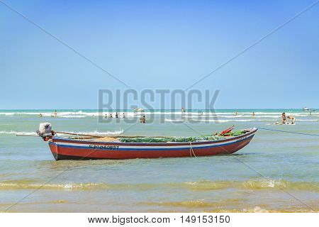 JERICOACOARA, BRAZIL, DECEMBER - 2015 - Small boat at the most famous beach of Jericoacoara in Brazil