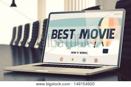 Best Movie - Landing Page with Inscription on Mobile Computer Display on Background of Comfortable Meeting Room in Modern Office. Closeup View. Blurred Image with Selective focus. 3D Illustration.