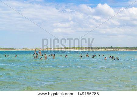 JERICOACOARA, BRAZIL, DECEMBER - 2015 - People bathing at Lagoa do Paraiso in Jericoacoara in Brazil