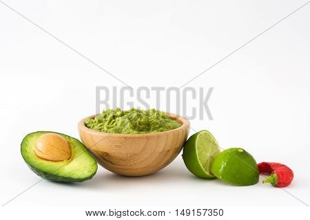 Nachos, guacamole and ingredients isolated on white background