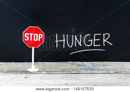 Stop Hunger Message Written On Chalkboard