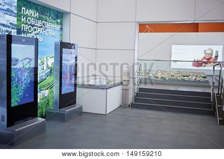 MOSCOW, RUSSIA - DEC 20, 2014: Hall with lightboxes and layout of city at VDNKH exhibition. Parks and public spaces of Moscow.