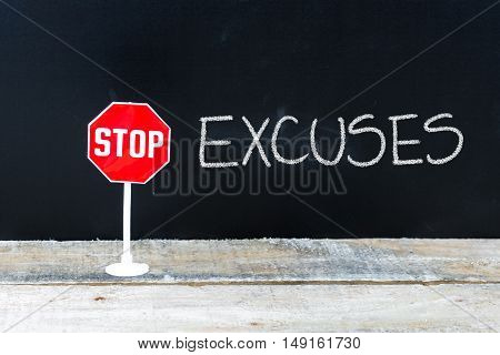 Stop Excuses Message Written On Chalkboard