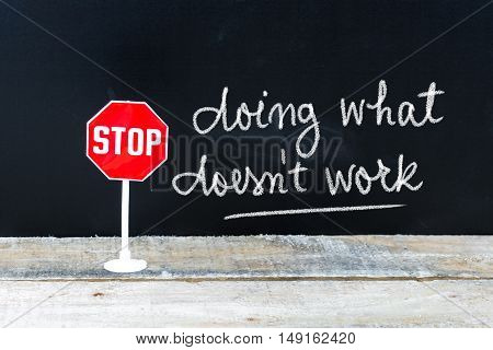 Stop Doing What Does Not Work Message Written On Chalkboard
