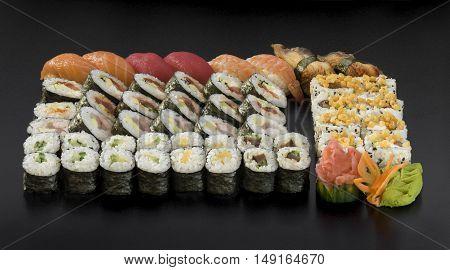 Mix colorful sushi Traditional japanese food Isolation on a black background