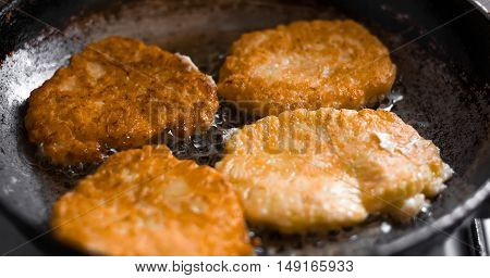 Frying nuggets. Chicken nuggets in a pan.Selective focus
