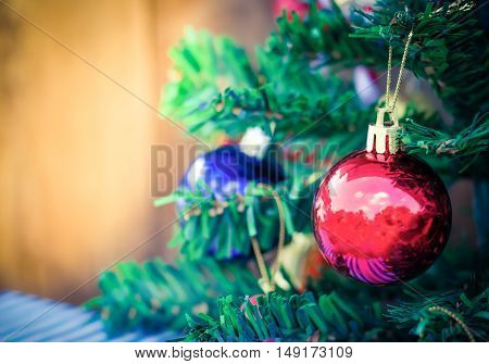 Christmas tree background with a red ornament