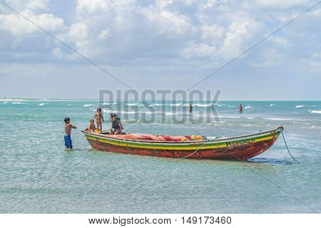 JERICOACOARA, BRAZIL, DECEMBER - 2015 - Mother with children at small boat at the most famous beach of Jericoacoara in Brazil