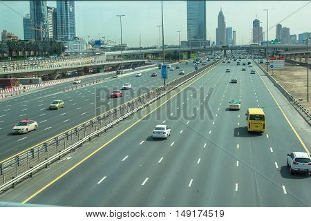 Dubai, United Arab Emirates - May 2, 2013: traffic on Sheikh Zayed Road, the highway E 11, which runs through Dubai.