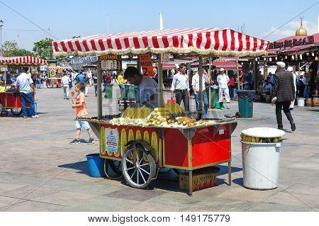 Unidentified Street Vendor Sells Corn On A Street
