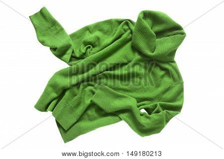 Green cashmere crumpled sweater on white background