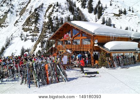 Les Arcs Alps France - March 18 2016: People are eating and drinking at a chalet style restaurant after skiing and snowboarding in Les Arcs Alpine Ski Resort