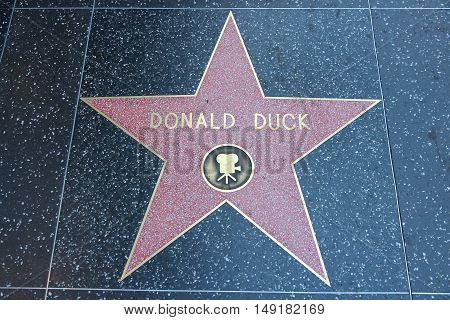 LOS ANGELES USA - APRIL 5 2014: Donald Duck star at famous Walk of Fame in Hollywood. Hollywood Walk of Fame features more than 2500 stars with inscribed celebrity names.