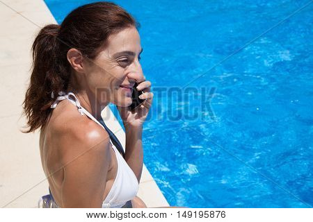 Happy Face Woman Talking On The Phone On Curb Pool