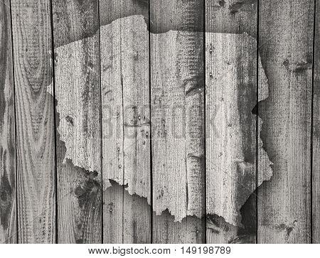 Map of Poland on weathered dark wood