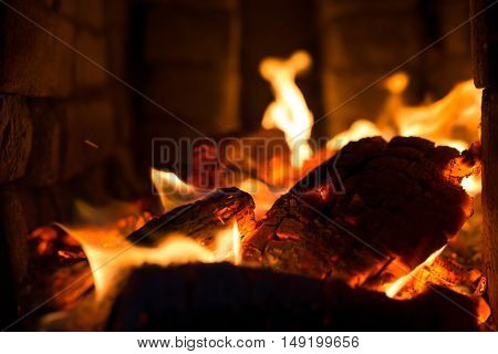 embers with flames in the stone oven