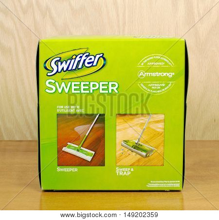 RIVER FALLS,WISCONSIN-SEPTEMBER 27,2016: A box of Swiffer brand dust sweepers with a wood background.