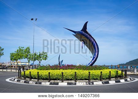 Kota Kinabalu, Malaysia - September 01, 2016: A Giant Swordfish Statue Stands In The Center Of A Rou
