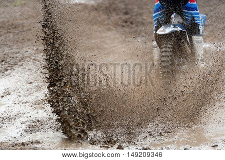 Motocross rider make huge mud splash on race