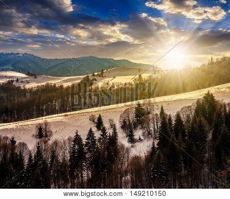 mountainous rural area of Carpathians in winter on fresh frosty evening