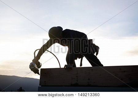 A carpenter working on a consruction site