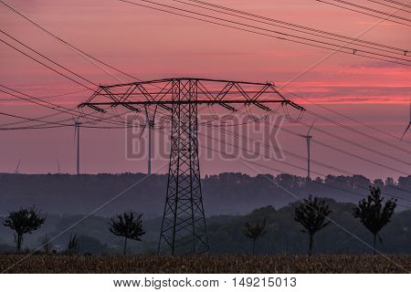 Electricity pylons and lines at dusk, Silhouette electricity pylons during sunrise.