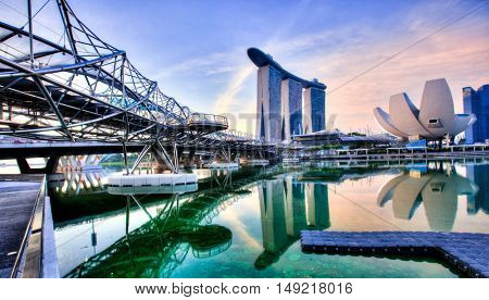 SINGAPORE, 4 April 2016 - Singapor'es famous Marina Bay Sands and Helix footbridge at sunrise