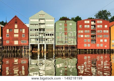 Old storehouses at Trondheim reflecting in the river Nidelva Norway